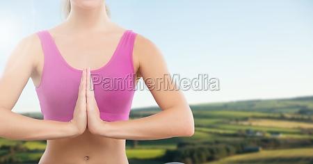 woman praying yoga meditating in front