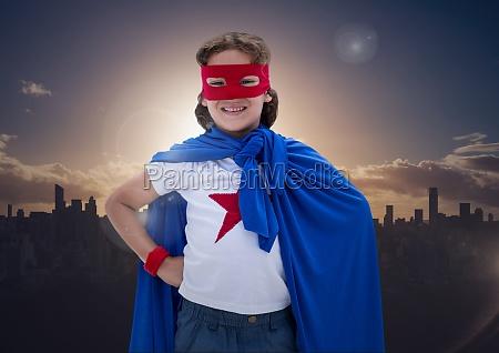boy in superhero costume standing with