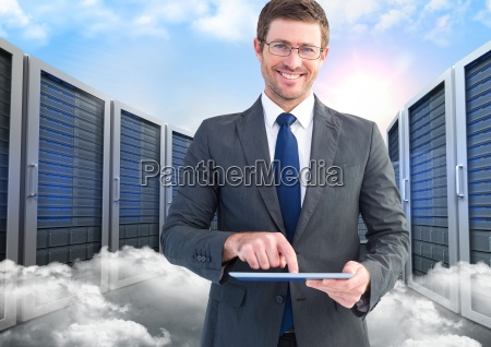 portrait of smiling businessman using digital
