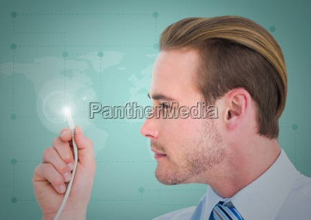 businessman holding a cable with light