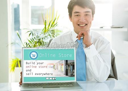 portrait of smiling man showing online