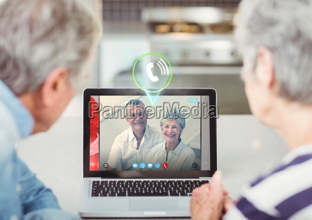 senior couple having video call with