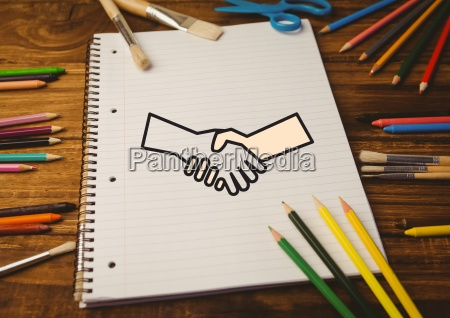 drawn handshake shape on notebook with