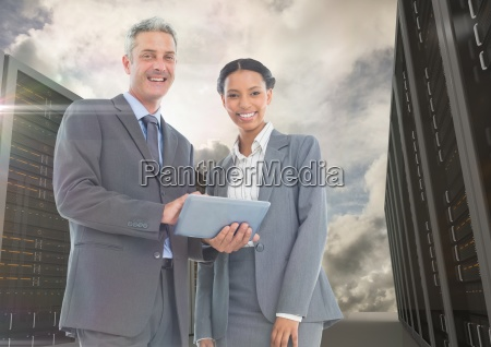 portrait of smiling businesspeople using digital
