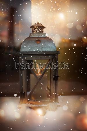 burning lantern in winter at christmas