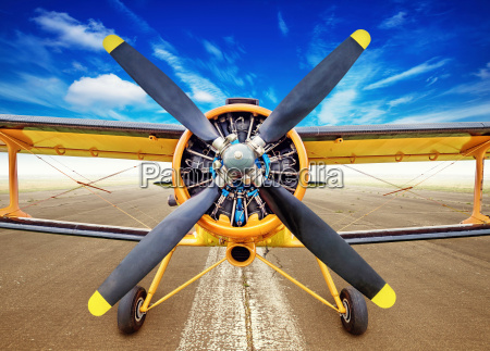 biplane on a runway ready for