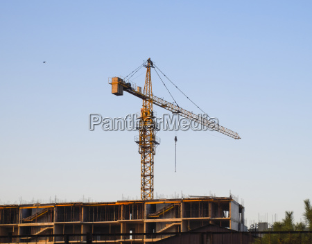 tower building crane near the new