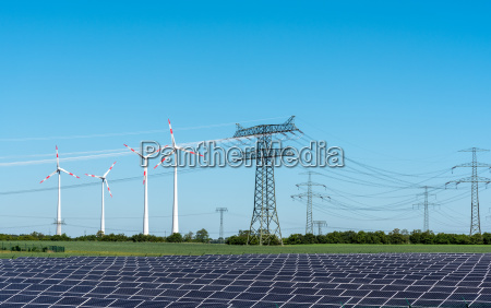 solar cells electricity pylons and wind
