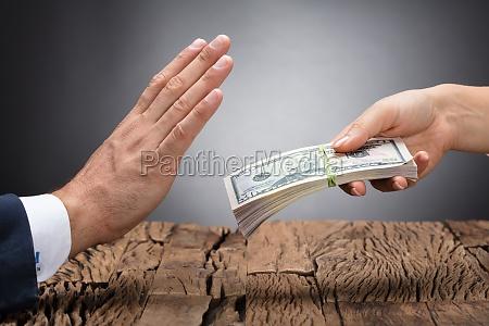 businessperson refusing to take bribe