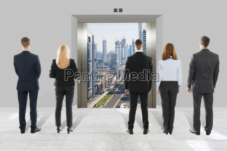 businessman and businesswoman looking at modern