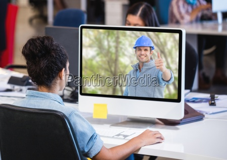 woman at office desk using computer