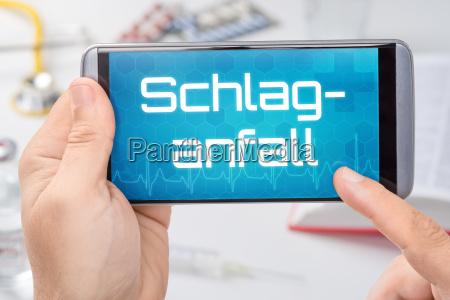 smartphone mit dem text schlaganfall auf