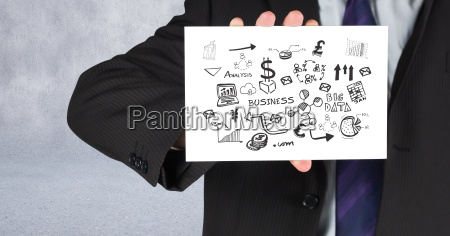 businessman holding card with business graphics