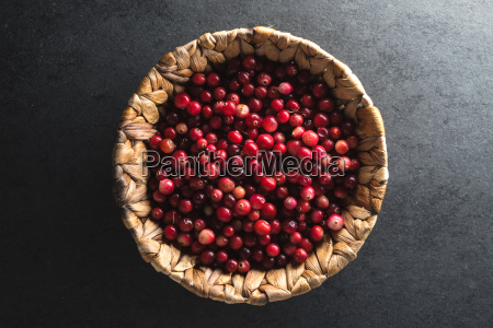 red cranberries in a basket on