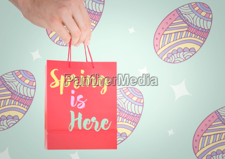 hand holding red bag with with
