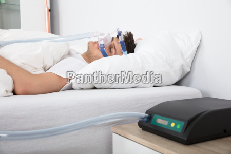 man lying on bed with sleeping