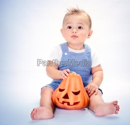 happy boy with pumpkin