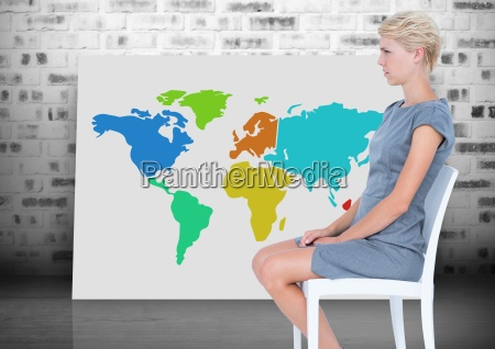 woman sitting on chair next to