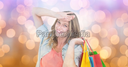 happy woman with shopping bags over