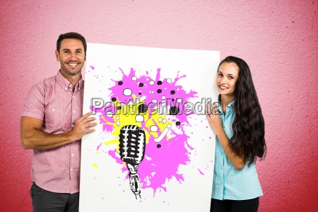 portrait of smiling couple holding billboard