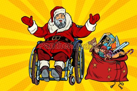 behinderter weihnachtsmann ist in einem rollstuhl