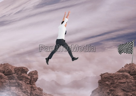 geschaeftsmann der mit seinen haenden springt
