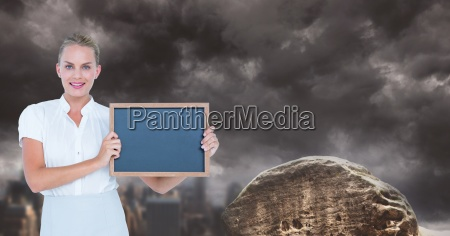 businesswoman showing blank slate against cloudy