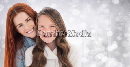 mother and daughter against white bokeh