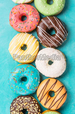 donuts on blue background top view