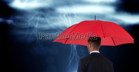 rear view of businessman holding red