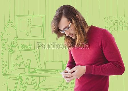millennial man texting against green hand
