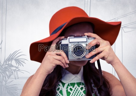 millennial woman with sunhat and camera
