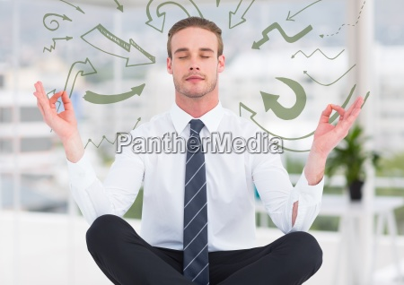 business man meditating in blurry white
