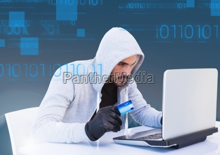 hacker holding a 3d credit card