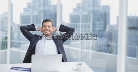 happy business man at a desk