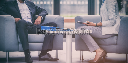 businessman sitting on armchair and talking
