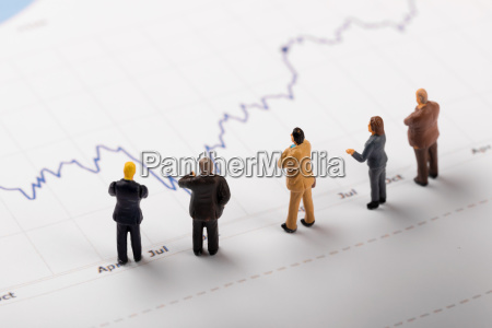 businessmen analyzing business financial graph reports