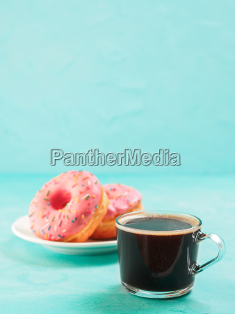 pink donuts on blue background