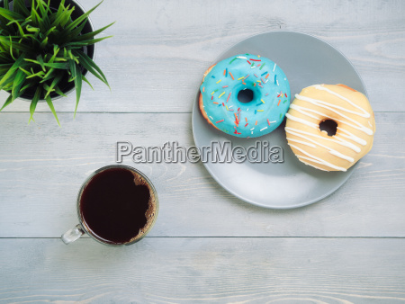 donuts and coffee on gray wooden