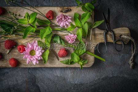 flowers raspberries and mint
