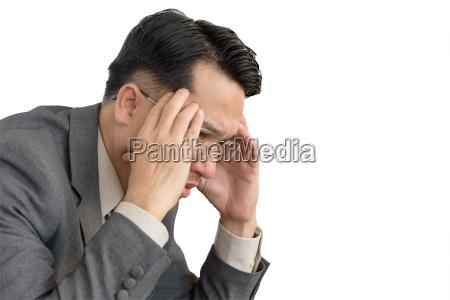 worried businessman sitting after losing job