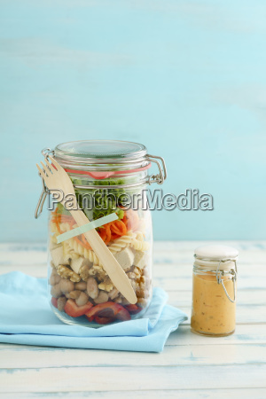 preserving jar of vegan mixed salad