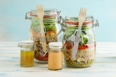 preserving jars of mixed salads and
