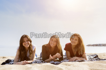 portrait of three female friends relaxing