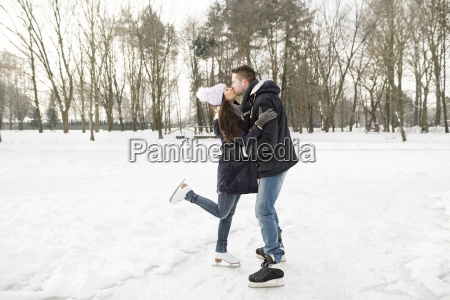 couple ice skating on a frozen