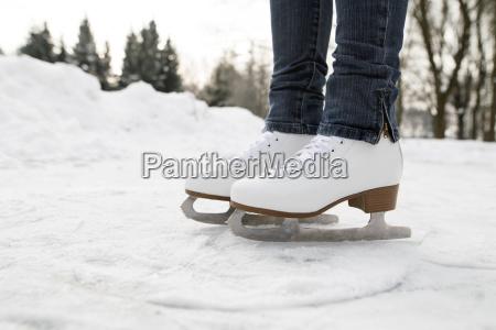 feet of woman wearing ice skates