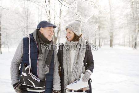 senior couple with ice skates in