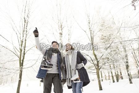 senior couple with ice skates in