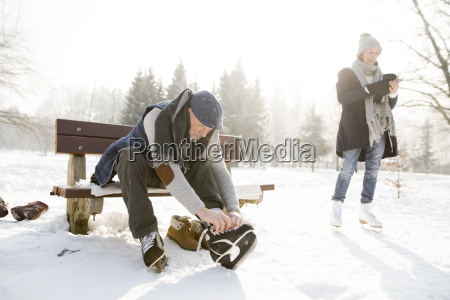 senior man sitting on bench in