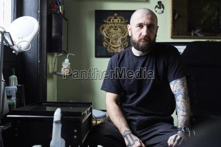 portrait of tattoo artist in studio